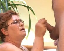 GERMAN GRANNY WITH GLASSES FUCKED BY A CUSTOMER