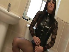 Crossdresser Zoe wanks her massive wet 9 inch big cock in the bathroom