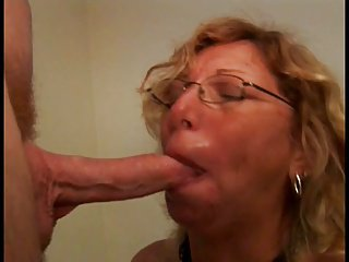 An old milf slut in glasses sucks a mean cock