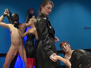 3 dommes, 2 slaves & a rubberdoll