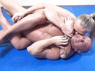 powerful blonde wrestles and stongfully masturbates guy
