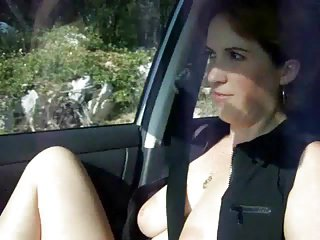 Flashing in her car AP69