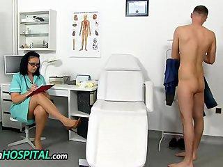 Skinny boy receives a handjob from a cougar