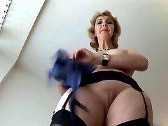 Mature English blonde babe in stockings upskirt tease